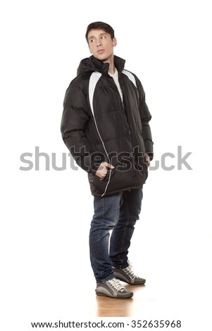 young handsome man posing with winter jacket - stock photo