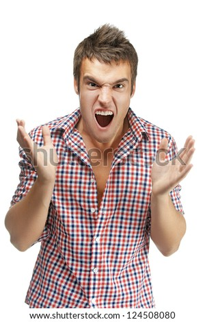 Young handsome man shouts, is isolated on a black background. - stock photo