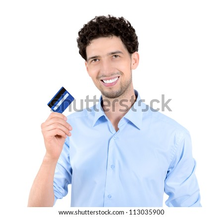 Young handsome man showing credit card. Isolated on white.