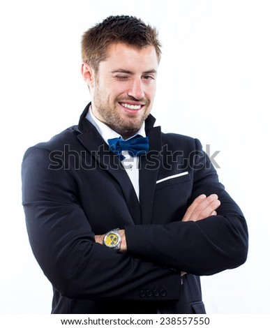 Young handsome man smiling and winking - stock photo