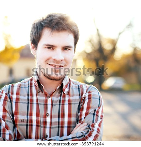 Young handsome man smiling having fun outdoor in park  - stock photo