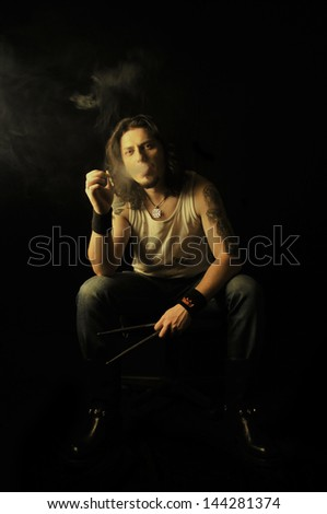 Young handsome man smoking - stock photo