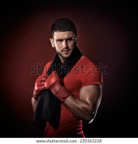 young handsome man standing with towel around his neck - stock photo