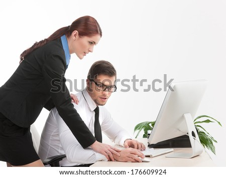 young handsome man surprised and puzzled. beautiful woman touching coworker shoulder and hand - stock photo