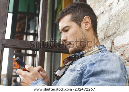 Young Handsome Man Using Mobile Phone Outdoor