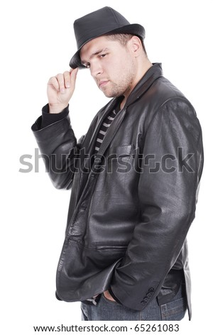 Young handsome man wearing black hat - stock photo
