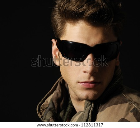 Young handsome man wearing dark sunglasses