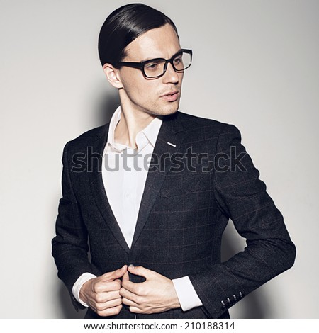 Young handsome man wearing fashion eyeglasses against neutral background  - stock photo