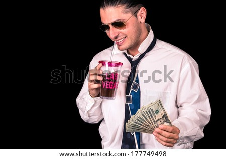 Young handsome man winning in Las Vegas - stock photo