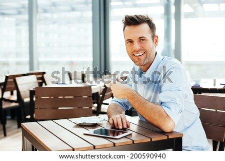 Young handsome man with a cup of coffee - stock photo