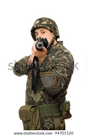 Young handsome man with a gun. Isolated