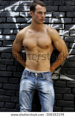Young handsome man with beautiful muscular body. - stock photo