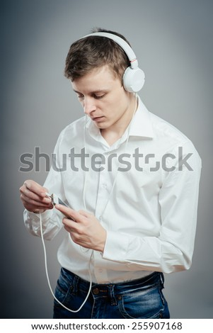 Young handsome man with earphones listen to music