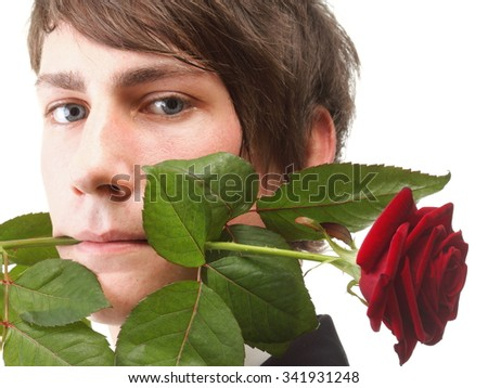 Young handsome man with flower in mouth, red rose isolated white background