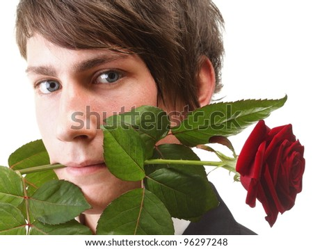 Young handsome man with flower, red rose isolated white background