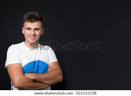 Young handsome man with great smile against neutral background with lots of copy space - stock photo