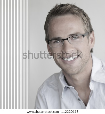 Young handsome man with great smile wearing fashion eyeglasses against neutral background with copy space - stock photo