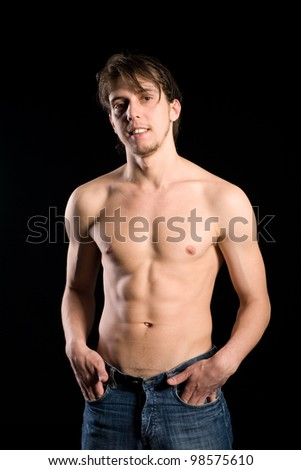 Young handsome man with naked torso - stock photo