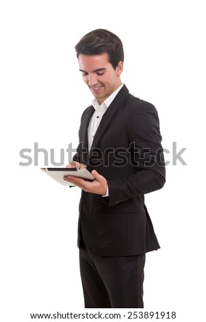Young handsome man working with tablet computer - stock photo