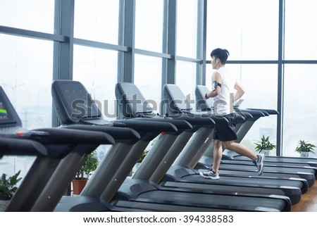 young handsome man works out in modern gym