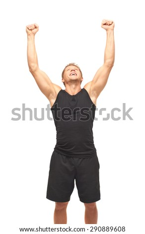 Young handsome muscular happy champion, rejoicing his victory, isolated on white background