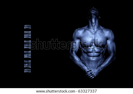 Young handsome naked athlete in metal blue color