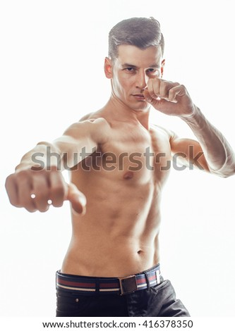 young handsome naked torso man boxing on white background isolated, lifestyle sport people concept