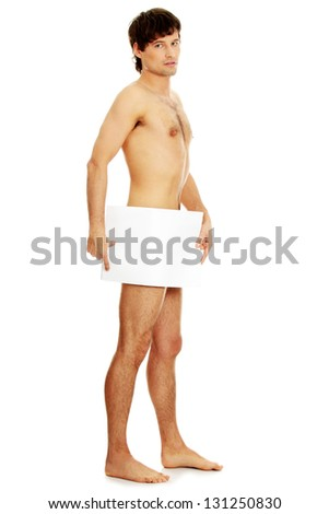 Young handsome nude man covering his self with a copy space blank billboard isolated on white - stock photo