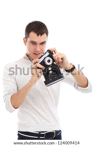 Young handsome photographer in studio - stock photo