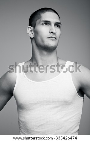 Young handsome sexy athlete in a white shirt