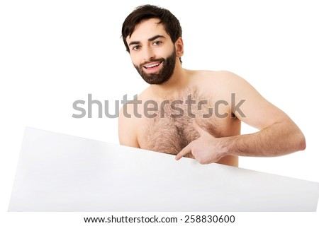 Young handsome shirtless man pointing on empty banner. - stock photo