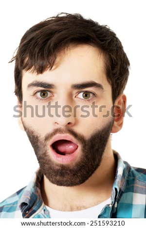 Young handsome shocked man with mouth open. - stock photo