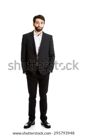 Young handsome smiling businessman standing. - stock photo