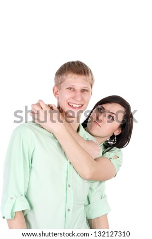 young handsome smiling guy and agressive girl