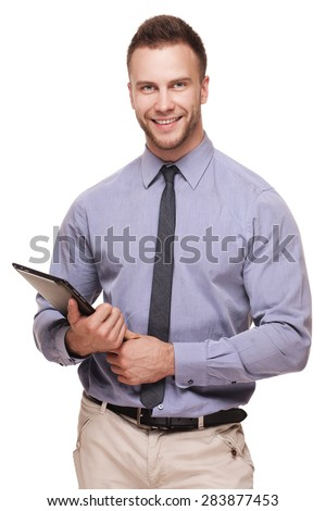Young handsome smiling man with tablet computer isolated over white background