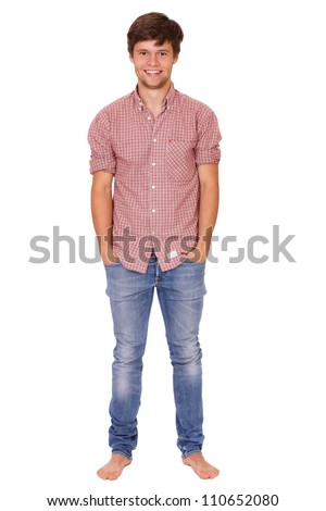 Young handsome smiling standing guy in blue jeans, isolated on white