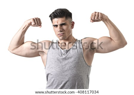young handsome sport man posing with strong naked torso looking cool and defiant showing big shoulders and biceps in healthy lifestyle and gym club bodybuilding advertising concept - stock photo