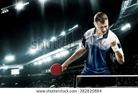 Young handsome sportsman celebrating flawless victory in table tennis - stock photo