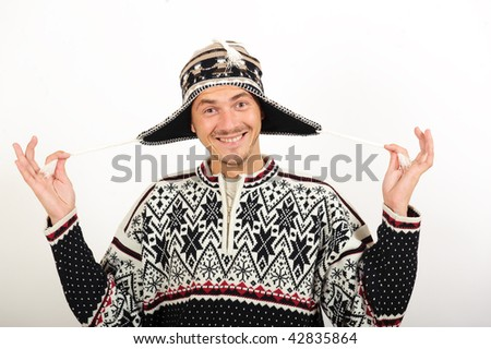 Young handsome winter man in knit clothes - stock photo