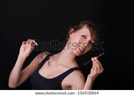 Young handsome woman decides for elektronic cigarette - stock photo
