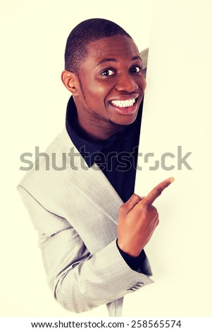 Young happy african businessman with blank board. - stock photo
