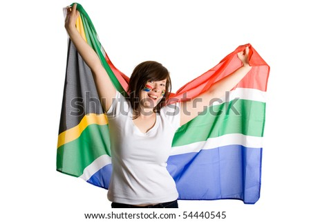 young happy and cheerful female, holds south africa flag, and have her cheeks painted with south africa flags, south africa world cup supporter, isolated on white background
