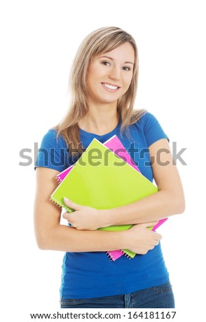 Young happy and satisfied student holding workbook. Isolated on white.