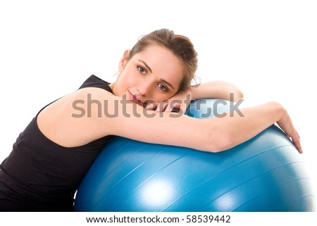 young, happy and very attractive woman with blue fitness ball, studio shoot isolated on white background - stock photo