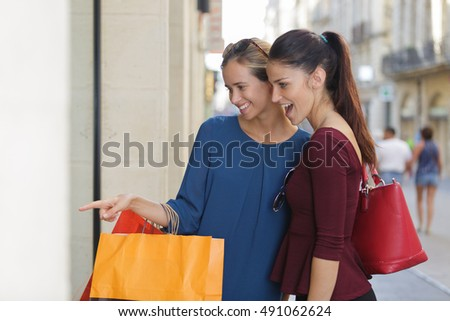 young happy and wealthy women shopping