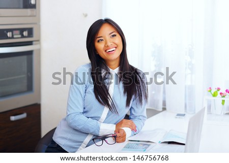 Young happy asian businesswoman in the morning at home