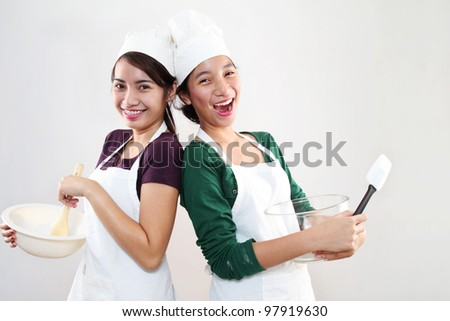 Young happy asian female chefs - stock photo