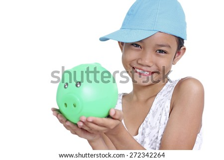 Young happy asian girl holding a piggy bank. Isolated in white background. - stock photo