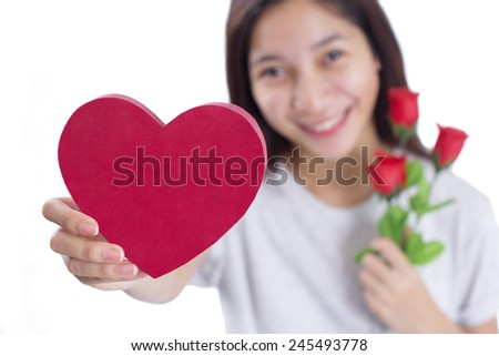 Young happy asian lady with a heart shaped red card and roses. Valentines day concept. Isolated in white background. - stock photo