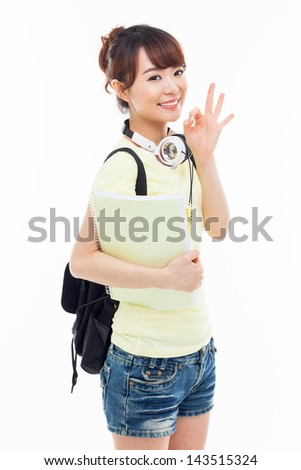 Young happy Asian student show OK sign isolated on white. - stock photo